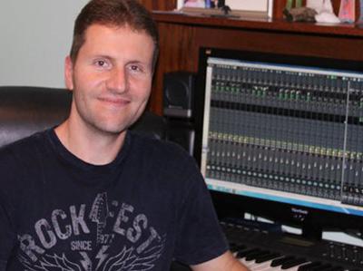 Rob in his home recording studio